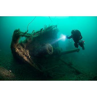 Diver exploring the wreck of the SS Laurentic ocean liner sunk during WW1 Poster Print by Steve JonesStocktrek Images