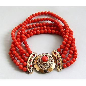 Bracelet with red coral and gold lock