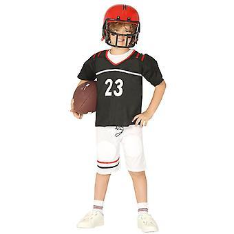 Garçons le quaterback de Football américain costumé