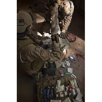 US Air Force CSAR parajumpers giving first aid Poster Print