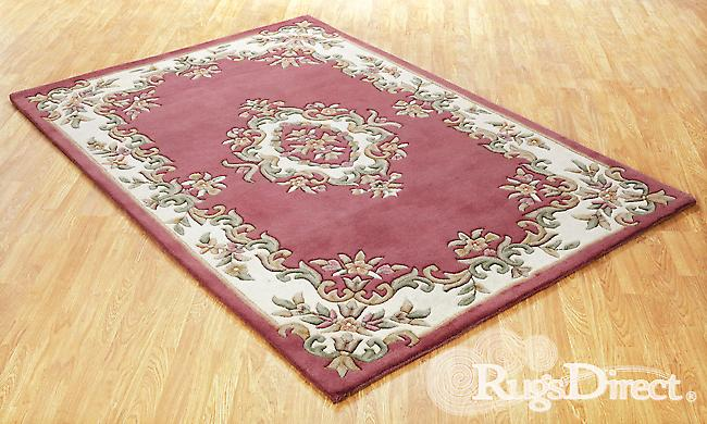 Royal Indian Rose Shades of cream, green and beige on a rose / pink background  Half Moon Rugs Traditional Rugs