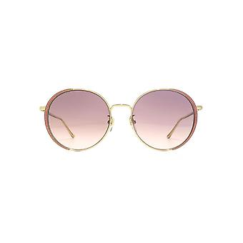 Gucci Guilloche Embellished Round Sunglasses In Gold Pink