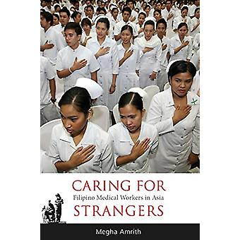 Caring for Strangers - Filipino Medical Workers in Asia by Megha Amrit