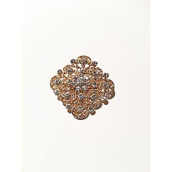 gold and crystal silver brooch