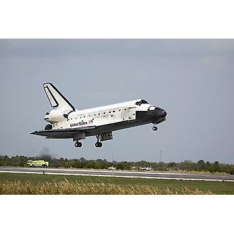 Space Shuttle Discovery approaches landing on the runway at the Kennedy Space Center Poster Print