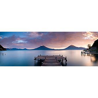 Jetty in a lake with a mountain range in the background Lake Atitlan Santa Cruz La Laguna Western Highlands Guatemala Poster Print