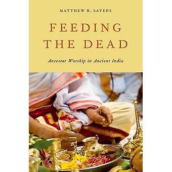 Alimentando a adoração de antepassado morto na Índia antiga por um Sayers & R. Mateus