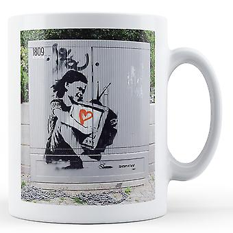 Printed mug featuring Banksy's, 'Girl Love Television Hug' artwork
