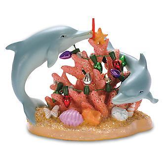 ميل بحري الدلافين السباحة في المحيط المرجان مزينة لزخرفة عيد الميلاد.