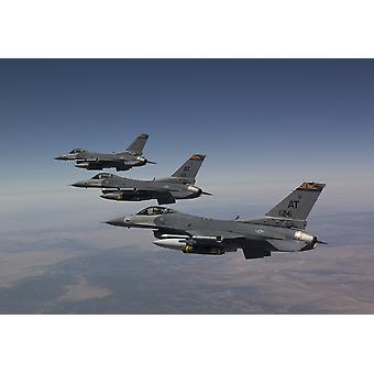 Three F-16s from the Air National Guard Air Force Reserve Test Center fly in formation during a test mission out of Tucson International Airport Arizona Poster Print