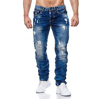 Mäns Jeans förstörde ställen hål sprickor sten tvättade röda vita Detaljer