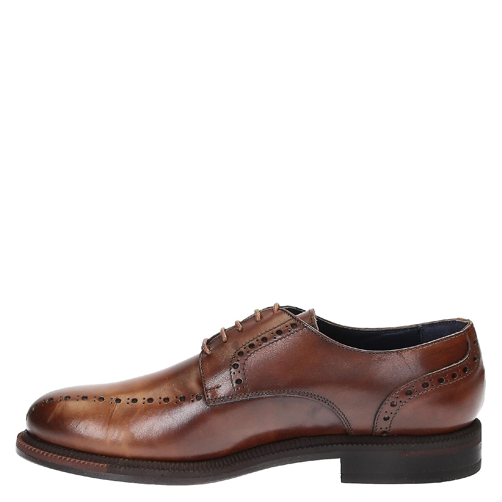 Handmade men's dress shoes in brown leather