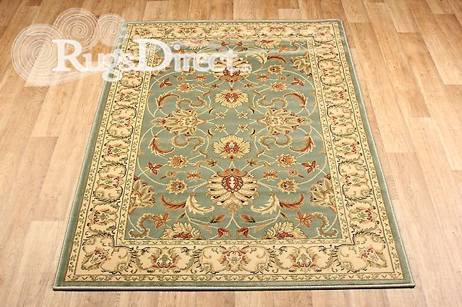 Kendra 45 L  Green background with a traditional floral green pattern and a beige border Rectangle Rugs Traditional Rugs