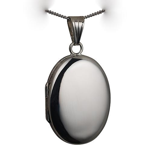 9ct White Gold 27x20mm plain oval Locket with a curb Chain 16 inches Only Suitable for Children