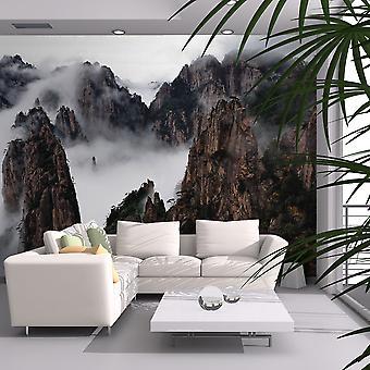 Tapet - hav af skyer i Huangshan Mountain, Kina