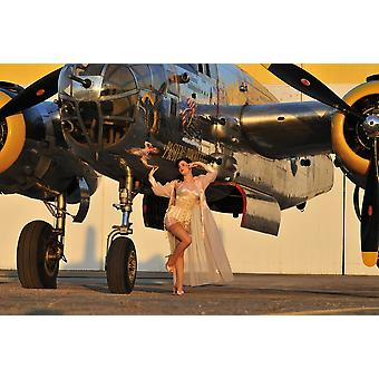 Sexy 1940s pin-up girl in lingerie posing with a B-25 bomber Poster Print