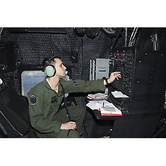 December 15 2011 - Senior Airman at work as Radio Operator in an MC-130P Combat Shadow of the 67th SOS during a training flight from RAF Mildenhall United Kingdom Poster Print