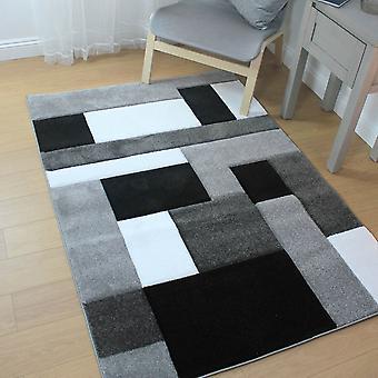 Handsnidad kosmos svart grå rektangel mattor moderna mattor
