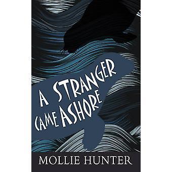 Un extraño llegó a tierra por Mollie Hunter - libro 9780863158834