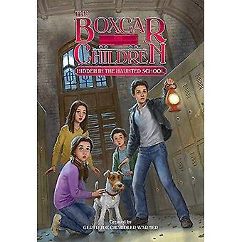 Gömd i hemsökta skolan (Boxcar barn mysterier)