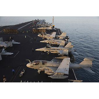 Aircraft parked on the flight deck of USS Dwight D Eisenhower at the end of another flying day in the Arabian Sea during Operation Enduring Freedom operations Poster Print