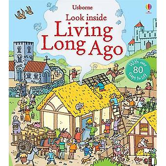 Look Inside Living Long Ago by Abigail Wheatley & Stefano Tognetti
