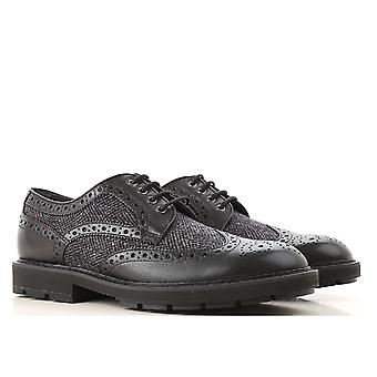 Tod's DERBY BUCATE man's lace-ups in leather and black fabric with brogue