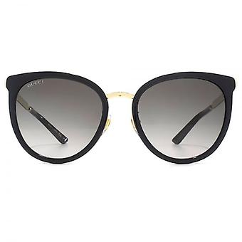 Gucci Peaked Round Sunglasses In Black Gold