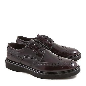 Handmade men's burgundy lux leather wingtip shoes