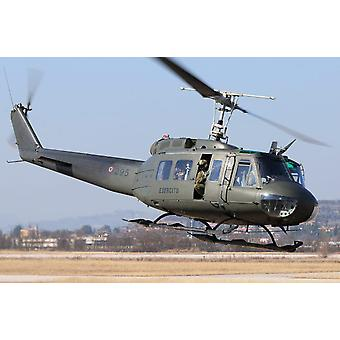 An Italian Army AB-205 helicopter taking off Poster Print by Daniele FaccioliStocktrek Images