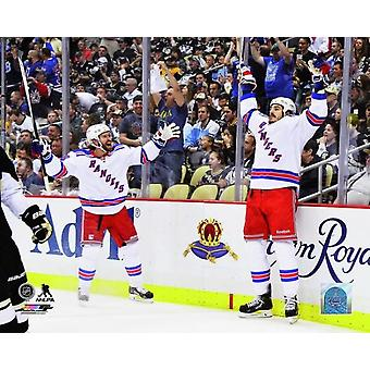 Dominic Moore and Brian Boyle of the New York Rangers celebrateafter Boyle scored a goal against the Pittsburgh Penguins in the first period of Game Seven of the Second Round of the 2014 NHL Stanley C
