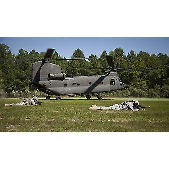 August 11 2011 - US Soldiers provide security for a CH-47 Chinook helicopter during an air assault mission at Fort AP Hill Virginia Poster Print